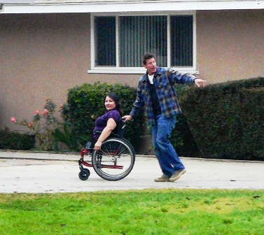 Ty Pennington and Maryann Riojas heading into her home to meet with her family and the builders
